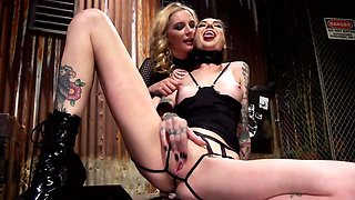 Blonde mistress uses strapon to penetrate submissive girl's holes