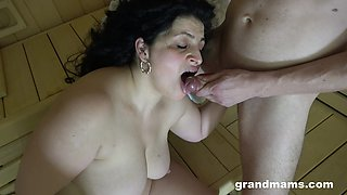 Messy haired chubby mature nympho is fucked doggy in the sauna
