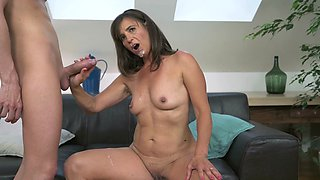 A granny gets semen in her face as she does a blow job