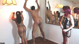 Redhead mistress worshiped by submissive couple