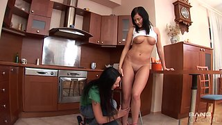 Masturbating in the kitchen pleases both Gabrielle and her friend