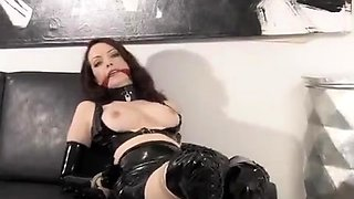 Brunette dressed in latex climaxes after masturbation