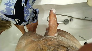 Mom washes her mature son and jerks off his dick