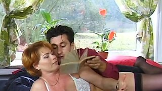 Busty milf Kira Red fucks with two big poles