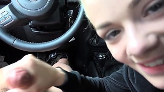 Beautiful blonde teen gives a wonderful handjob in the car