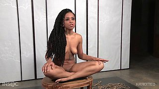 Hard-tied chocolate cutie experiences a pretty rough bondage session