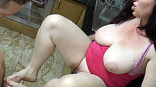 bbw stepmom gives footjob