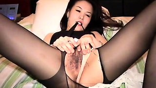 Asian cutie in pantyhose gets her hairy slit fucked deep