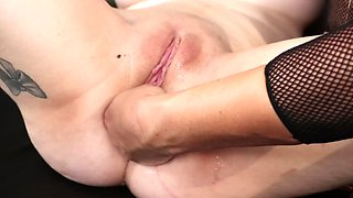 Blonde chick dominates naked slave with kinky anal fisting