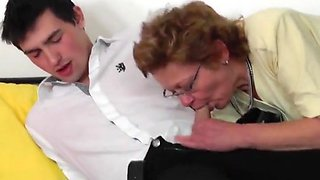 Comely buxomy mature lady blows the dick