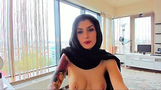 Stunning brunette camgirl in lingerie shows off her hot body
