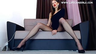 Elegant beauty in nylon tights spread her legs wide and smokes sexually