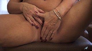 A bit plump housewife Olivia Westervelt gets nude and masturbates on the table
