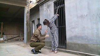 Chinese Prison Girl in Metal Bondage