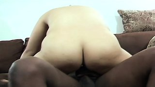 Chubby brunette with glasses passionately sucks and fucks a black cock
