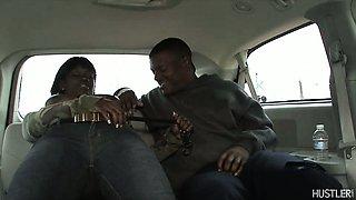 Busty black babe sucking in car