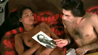 Ebony brunette sexpot Emanuelle gives head and rides white dick on top