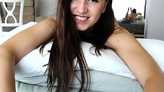 Beautiful camgirl sensually stripteases and rubs her pussy