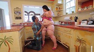 Big girl fucks her man on the kitchen floor