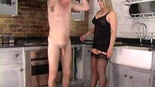 Femdom Corselette and Nylons Femdom-Goddess Spanks in the Kitchen