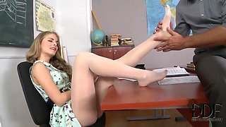 A sexy teacher has her toes sucked real well