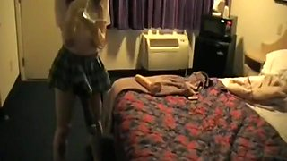 Dude gets strapon fucked by a girl in a motel